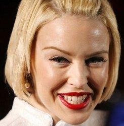 B) Quizzical, Asymmetrical Brow (Kylie Minogue)